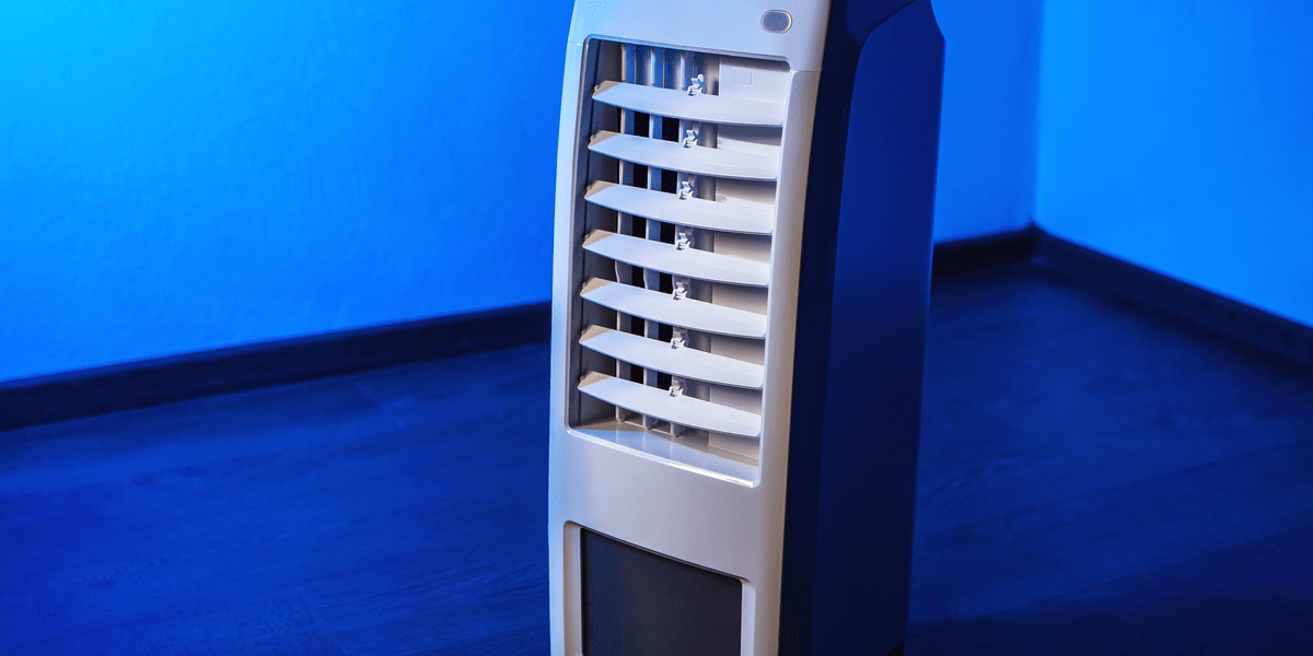 image of a portable air conditioner in dimmly lit room